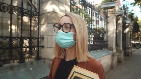 Female Student Wearing A Medical Mask