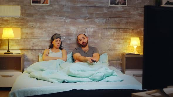 Thumbnail for Caucasian Couple Using Tv Remote Control
