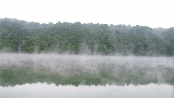 Morning fog over the river. Beautiful landscape.