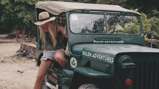 Male and Female Model Goes Down on a Green Jeep Visiting Historical Ruins