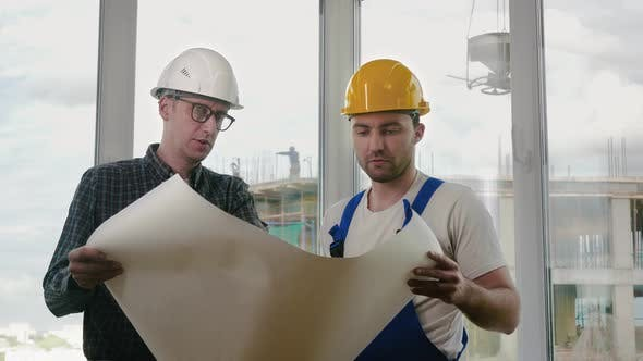 Thumbnail for Engineer and Construction Worker Discuss a Blueprint