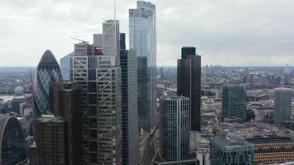 Slide and Pan Footage of Tall Modern Office Buildings with Glossy Glass Facades