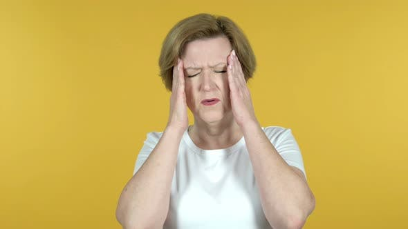 Thumbnail for Old Woman with Headache Isolated on Yellow Background