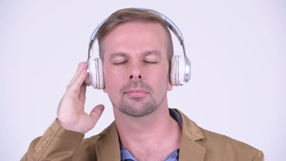Thumbnail for Happy Blonde Casual Businessman Listening To Music