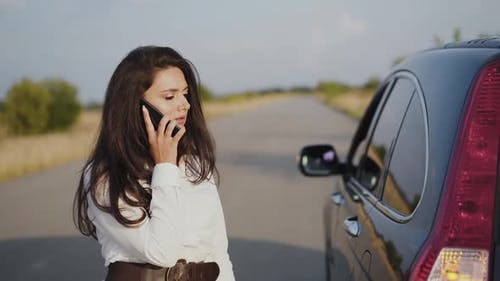 Irritated Alone Woman Talking on Phone at Broken Car Out of City