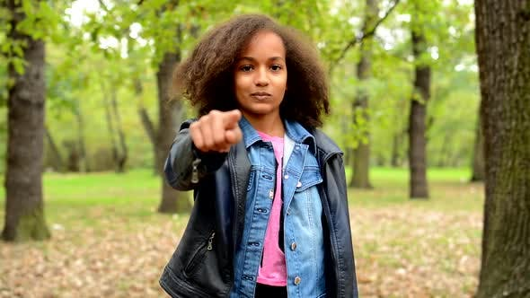 Thumbnail for Young African Happy Girl Show with Finger on You and Nod Her Head - in the Park