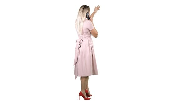 Thumbnail for Standing young beautiful girl making a call on white background.
