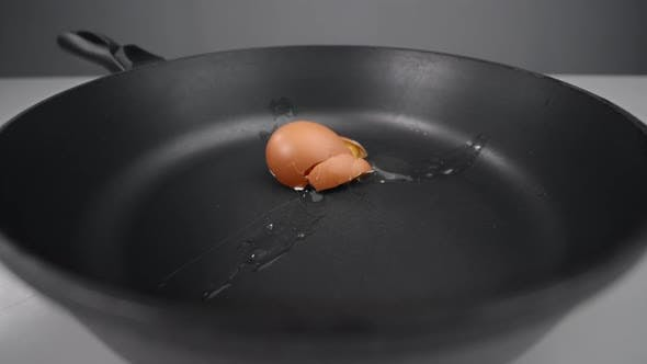 Thumbnail for Raw Egg Falls To the Pan and Smashes in Slow Motion, Falling Egg in 240 Fps, Cooking at the Kitchen