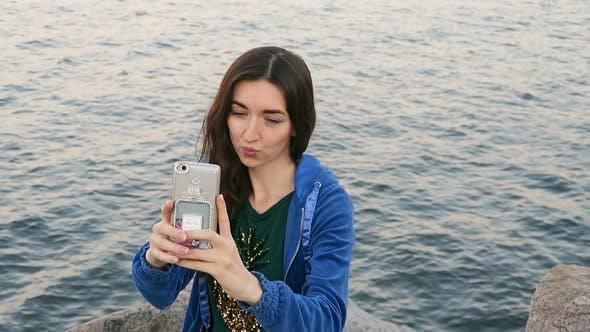 Thumbnail for Girl Makes Selfie On The Background Of The Sea