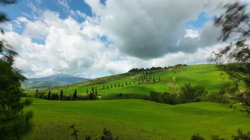 Time Lapse of the clouds over the rolling hills of Tuscany Italy.