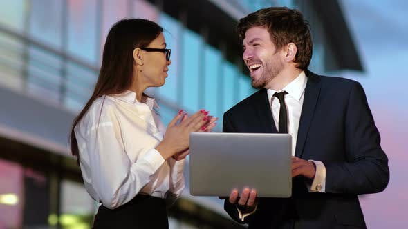 Thumbnail for Excited Business Couple Receiving Good News on Laptop