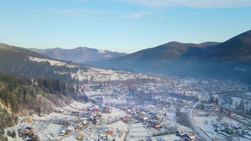 Aerial Drone View Beautiful Winter Mountains and a Valley in Which the Old Settlement Is Located