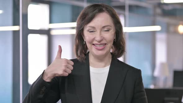 Thumbnail for Portrait of Cheerful Middle Aged Businesswoman Showing Thumbs Up