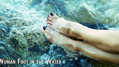 Woman Foot In The Water