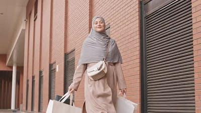 Arabic Woman with Shopping Bags Walking Outdoors