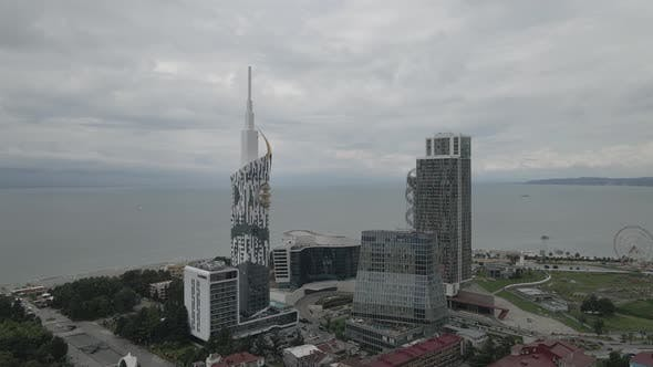 Thumbnail for Aerial shot of alphabetic tower, skyscrapers and embankment of beautiful city of Batumi, Georgia