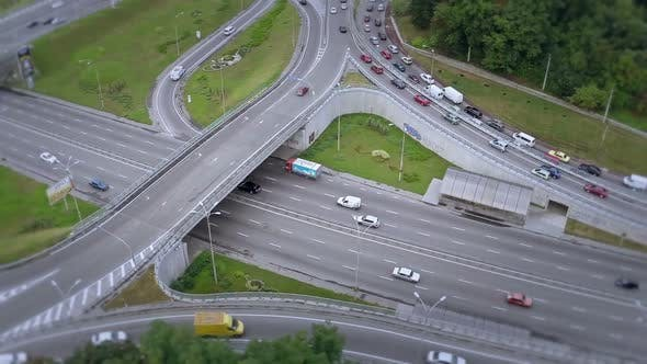 Thumbnail for Aerial Shot of Busy Road Junction, Fast and Slow-Driving Cars