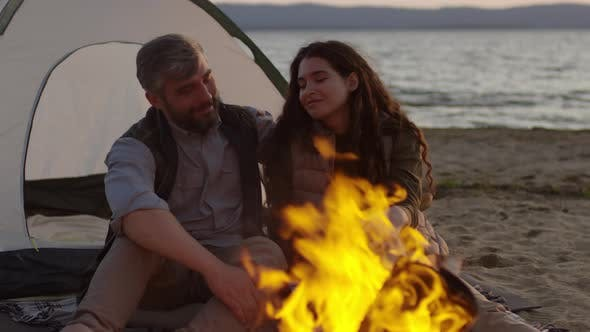 Thumbnail for Happy Couple Enjoying Campfire at Beach