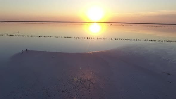 Cover Image for Aerial Short  of Surface Covered with White Sand at Black Sea Coast at Sunset