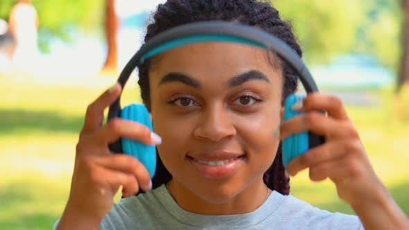 Thumbnail for Front View Close Up Face Cheerful African American Young Woman with Headphones