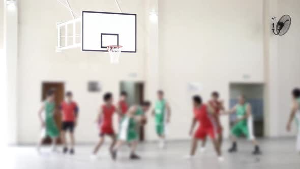 Thumbnail for Blurred Basketball Game in a School.