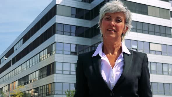Thumbnail for Business Middle Age Woman Smiles and Shows Thumbs Up To the Camera - Company Building