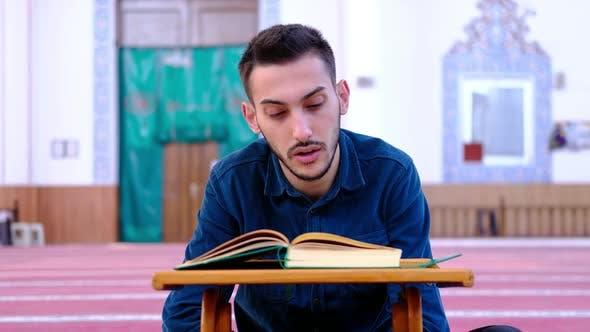 Man Reading Quran Mosque