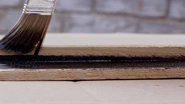 View of brush painting board with stain