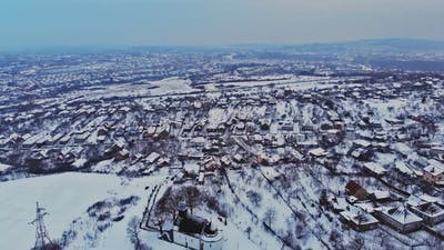 Overhead aerial view of residential houses and village houses covered in snow in winter time