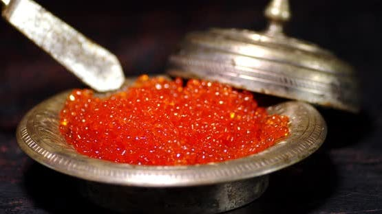 The Red Caviar in the Plate Is Stirred with a Spatula.