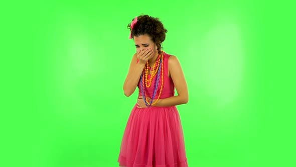 Thumbnail for Cute Female Feels Very Bad, Her Stomach Hurts, Feeling Nausea Against Green Screen at Studio.