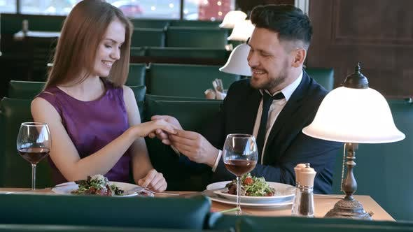 Thumbnail for Man Putting Ring on Finger of Woman on Date