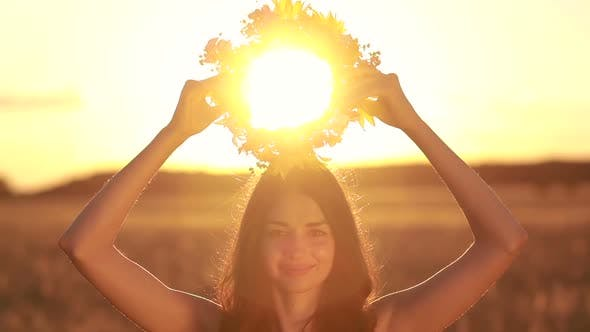 Thumbnail for Pretty Woman in Flower Wreath in Field at Sunset