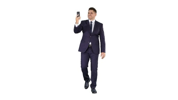 Cover Image for Young businessman using smartphone to videocall to business
