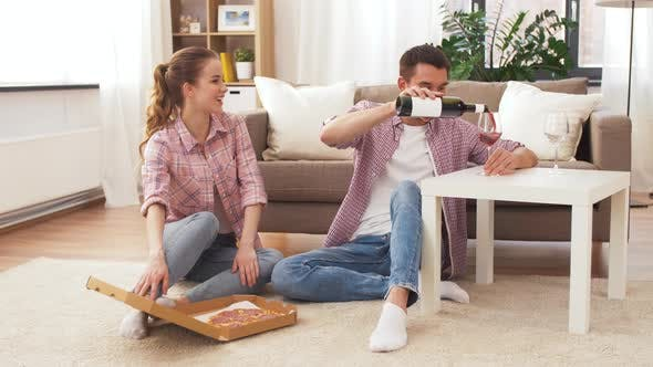 Cover Image for Couple with Wine and Takeaway Pizza at Home