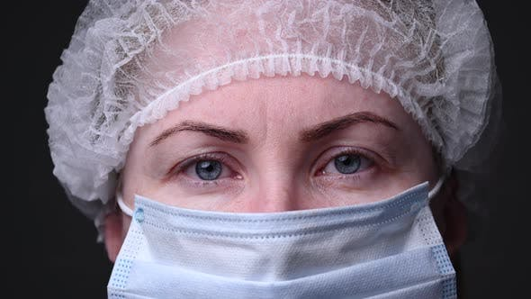 Thumbnail for Girl in a Protective Medical Mask. People Are Afraid of Contracting the Covid-19 Virus. The Epidemic