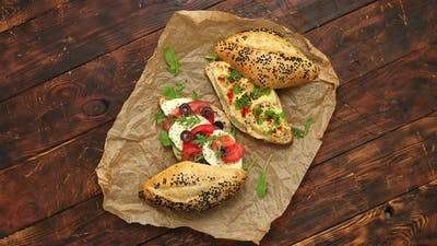 Healthy Food Concept. Sandwiches with Hummus, Mozarella, Tomato, Black Olives