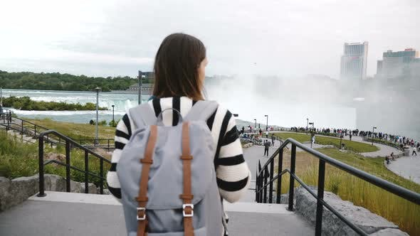 Thumbnail for Camera Follows Tourist Woman with Backpack Walking Towards Crowded Observation Deck at Famous