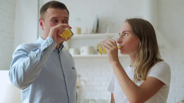 Thumbnail for Young Couple Drinking Fresh Orange Juice in Home Kitchen