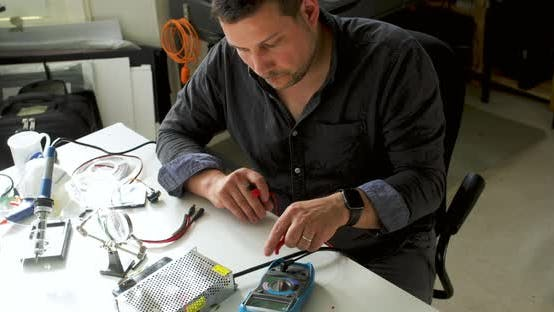 Thumbnail for Male electrical engineer working from home during Coronavirus lockdown, working on a power supply un