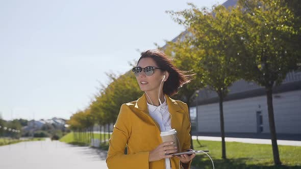 Young Woman in Suit and Sunglasses