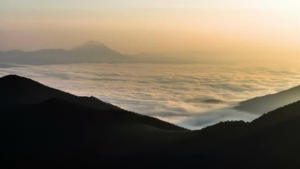 Thumbnail for Sea of Foggy Clouds Waves in Mountains Valley in Sunny Summer Morning Nature