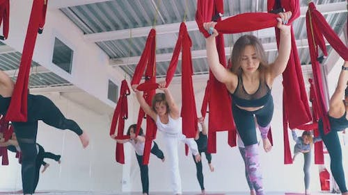 Ladies Improve Stamina and Stand in Modern Fly Yoga Asana