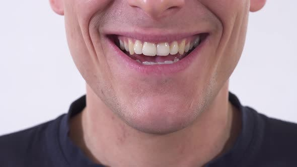 Thumbnail for Shooting Mouth of the Mad Man Is Smiling in Wide Unhealthy Smile
