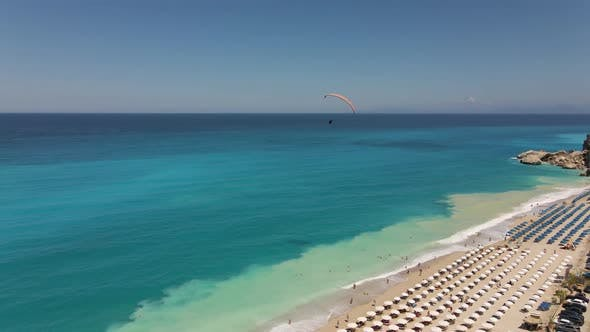 Thumbnail for Paragliding over the beach