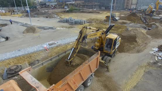 Aerial View of Construction Site with Working Machinery