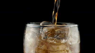 Pouring Coke Into Glass
