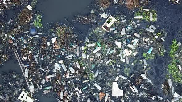 Rubbish plastic, bottle flow on water