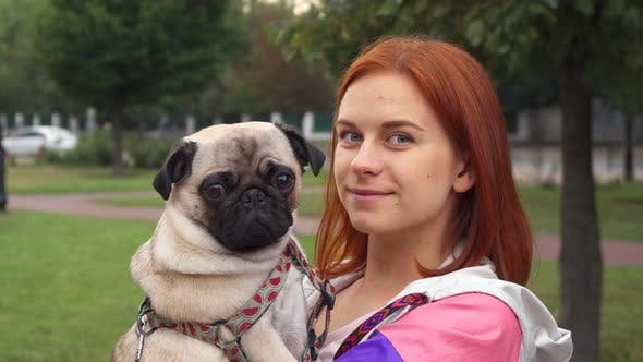 Thumbnail for Girl Holding Her Pug and Smiling at Camera