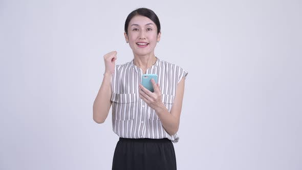 Thumbnail for Happy Beautiful Asian Businesswoman Using Phone and Getting Good News